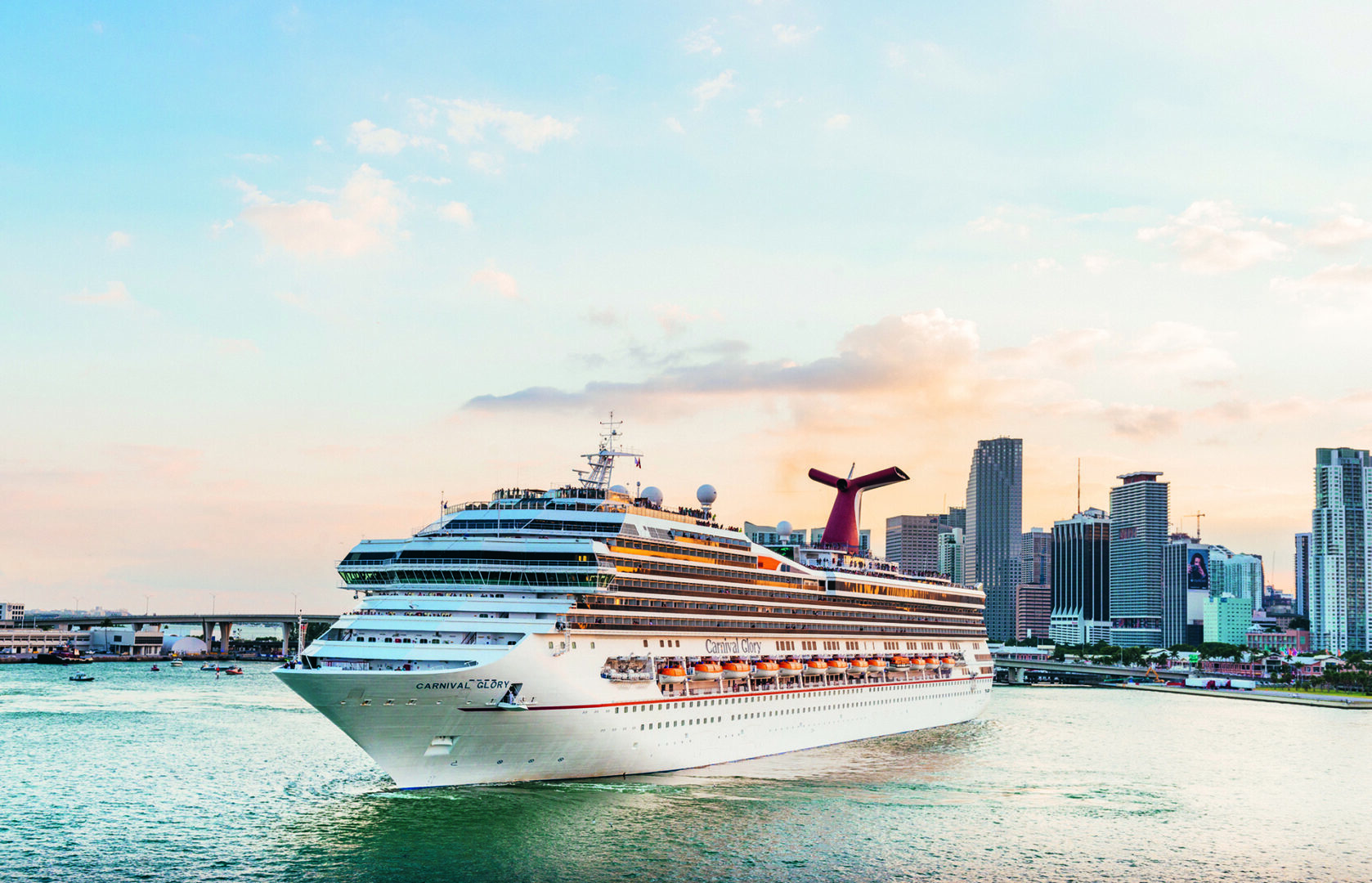Miami, United States - November 19, 2016: A large passenger cruise ship, the Carnival Glory, turns around in Biscayne Bay as it prepares to exit the downtown Port of Miami via Government Cut.